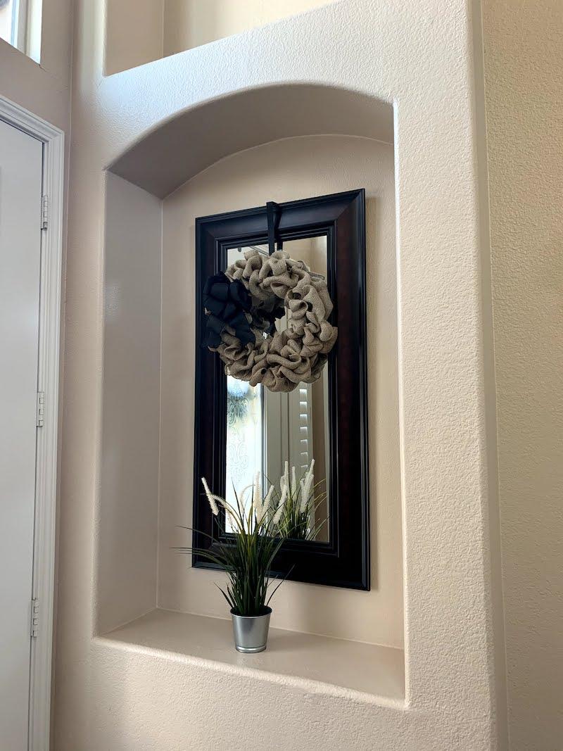 Burlap wreath hanging near front door