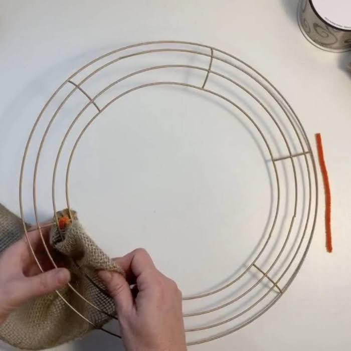 Pulling the burlap through the wire wreath